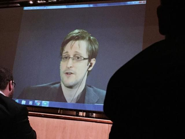Former National Security Agency contractor Edward Snowden speaks via video conference to people in the Johns Hopkins University auditorium in Baltimore.