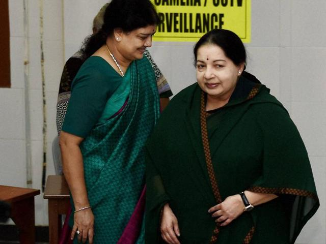 Tamil Nadu chief minister and AIADMK chief J Jayalalithaa along with her close aide Sasikala Natarajan after casting votes for the Assembly polls, in Chennai on Monday.
