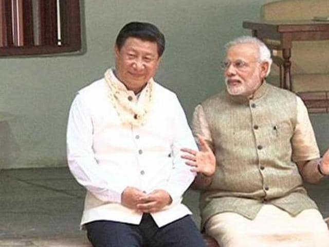 China's President Xi Jinping and Indian Prime Minister Narendra Modi share a quiet moment at the Sabarmati Ashram in Ahmedabad.
