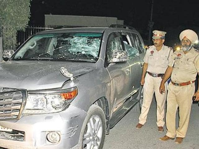 Police at the spot where the cavalcade of Sikh preacher Ranjit Singh Dhadrianwale was attacked in Ludhiana on Tuesday.