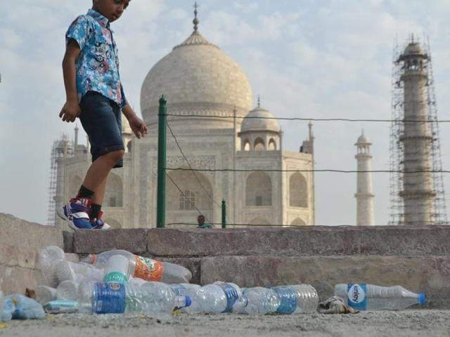 Plastic bottles lie littered on the Taj Mahal premises in the absence of a dedicated cleaning agency.