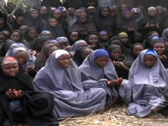 (FILES) This file photo taken on May 12, 2014 shows a screengrab taken from a video of Nigerian Islamist extremist group Boko Haram obtained by AFP showing girls, wearing the full-length hijab and praying in an undisclosed rural location.
