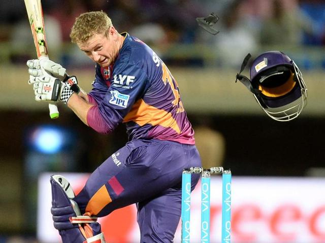 The helmet of rising Pune Supergiants batsman George Bailey falls down after it was hit by a ball.