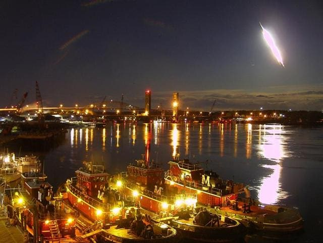 In this frame from video provided by portsmouthwebcam.com, a fireball streaks across the sky, at Portsmouth Harbour on Tuesday.