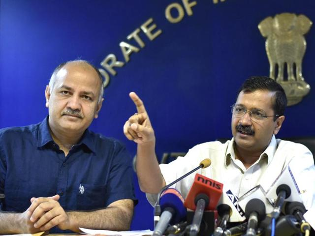 Delhi chief minister Arvind Kejriwal presents the statehood draft bill to media as his deputy Manish Sisodia looks on.
