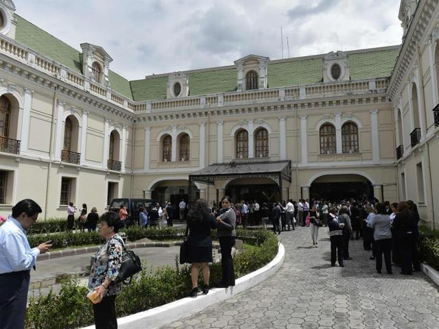 People remain outside the Foreign Ministry building in Quito on May 18, 2016.