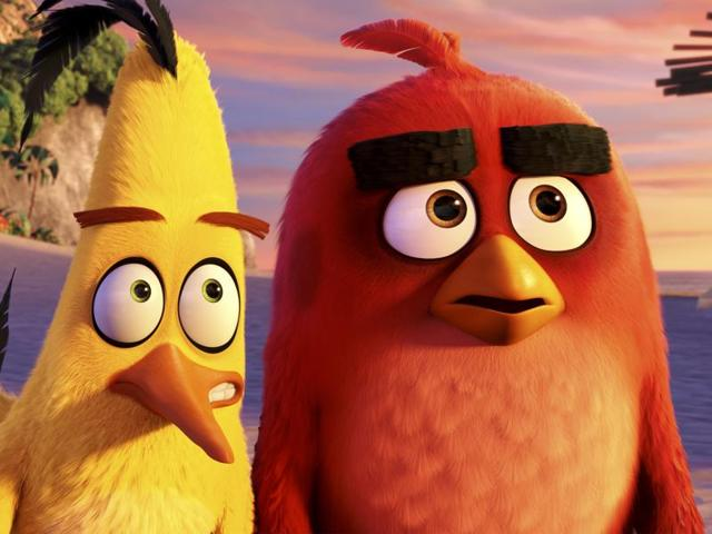 Characters Red, voiced by Jason Sudeikis, from left, Chuck, voiced by Josh Gad and Bomb, voiced by Danny McBride in a scene from The Angry Birds Movie.