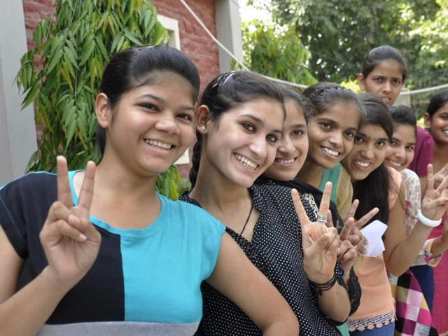 Class 12 students of UP board celebrate their success after the results on Sunday.