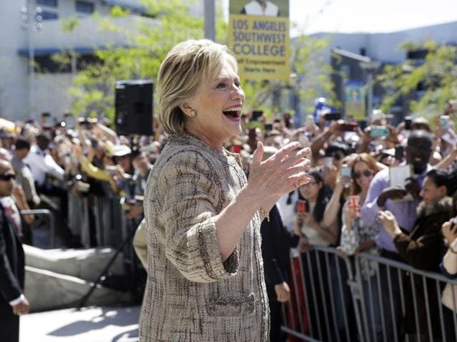 Democratic presidential candidate Hillary Clinton speaks to people in the overflow area during a campaign event at Los Angeles Southwest College in Los Angeles.