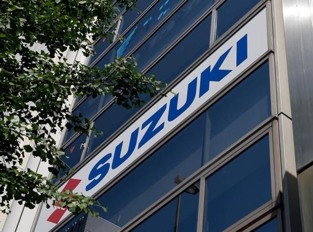 The logo for Japanese automaker Suzuki is displayed on the Suzuki Tokyo headquarters building in Tokyo on Wednesday.