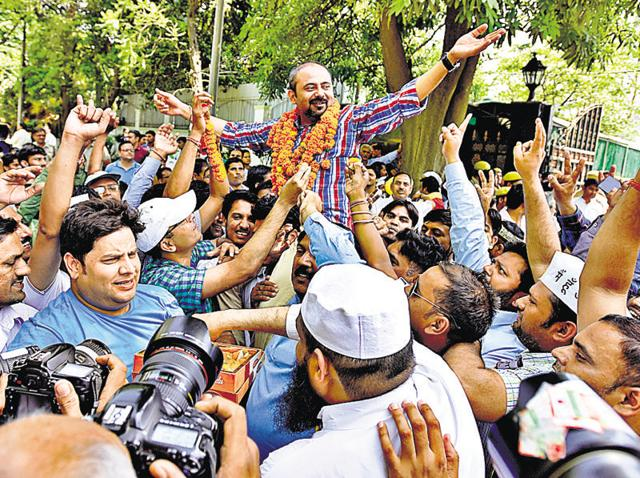 Congress candidate Anand Kumar along with his supporters celebrates victory at Khichripur in East Delhi.