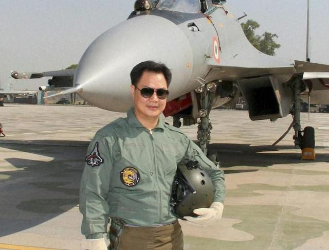 Minister of state for home Kiren Rijiju with a fighter pilot after a  raid on board Sukhoi 30-MKI.