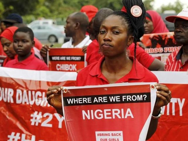 Members of the Bring Back Our Girls campaign group take part in a rally on the second anniversary of the abduction of Chibok schoolgirls by Boko Haram, in Abuja, Nigeria.