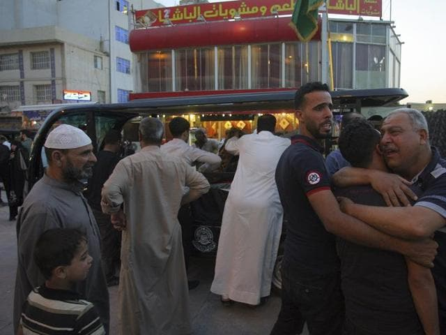 Mourners grieve during a funeral procession in Najaf, Iraq, May 11.