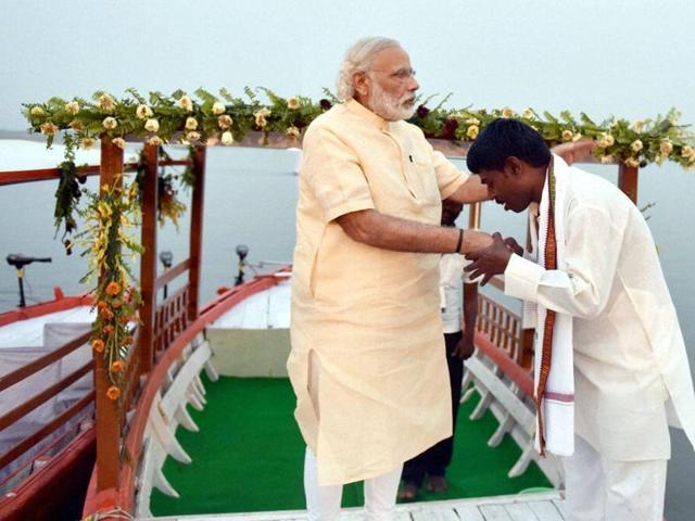 Prime Minister Narendra Modi on an e-boat in Varanasi.