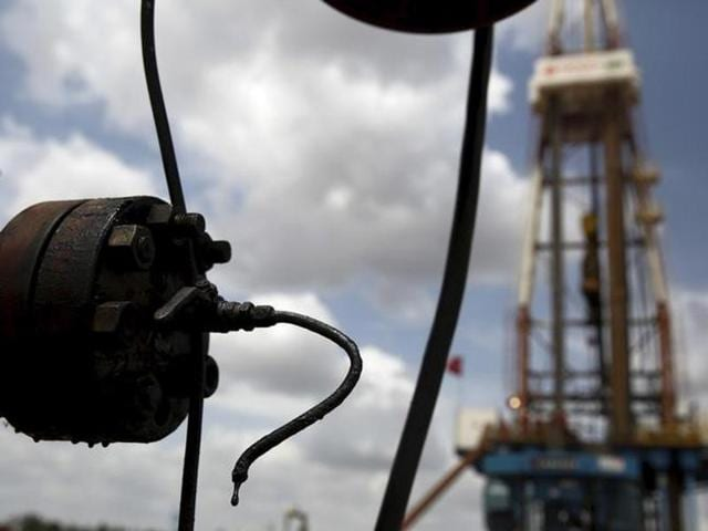 Crude oil drips from a valve at an oil well operated by Venezuela's state oil company PDVSA in the Orinoco belt, near Morichal at the state of Monagas.
