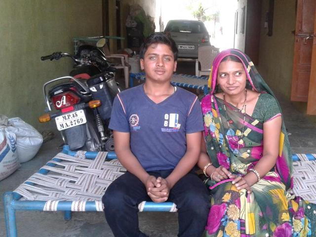 Premlata Patidar, 36, and her son Prashant Patidar at Barwate village in Jhabua district on Tuesday.