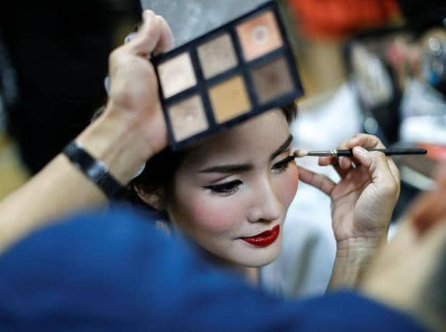 Another beauty contestant prepares backstage. (REUTERS)