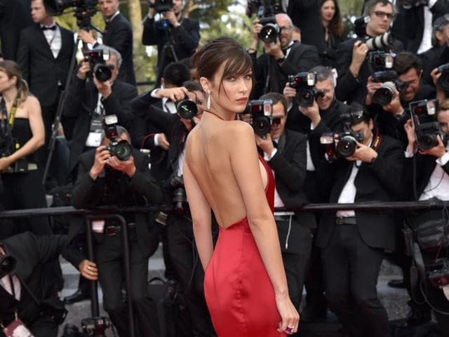 US model Bella Hadid poses as she arrives for the screening of the film The Unknown Girl at Cannes.