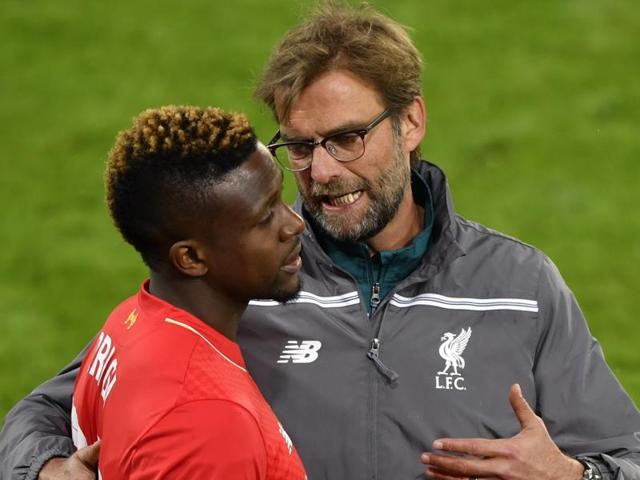 Liverpool's German coach Jurgen Klopp (R) speaks with forward Divock Origi during the UEFA Europa League.