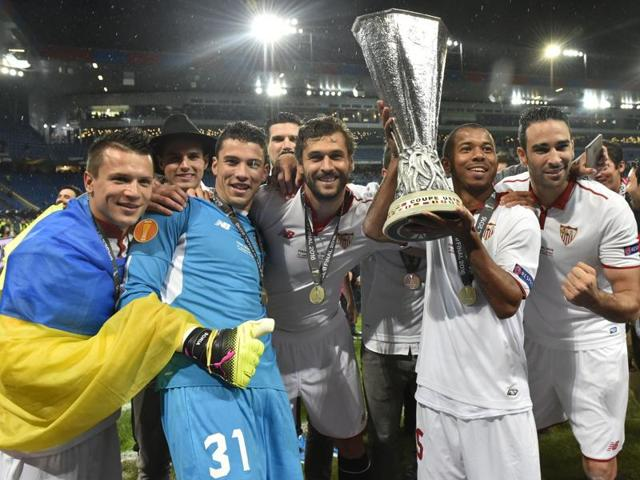 Sevilla players celebrate with the trophy after winning the UEFA Europa League final.