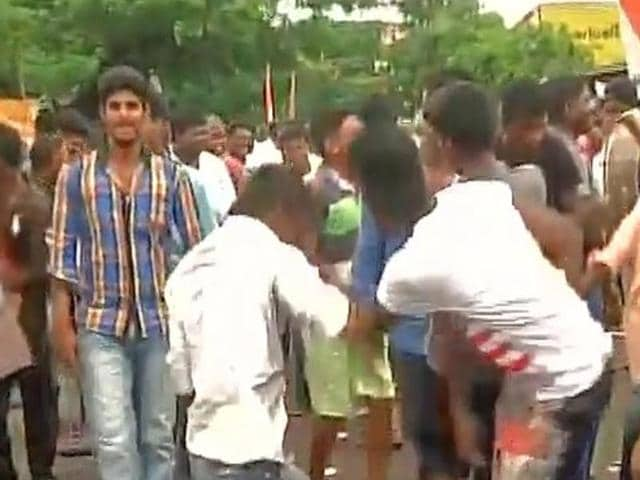Congress supporters celebrate as Congress wins 8 seats and is leading in 2 seats in Puducherry.