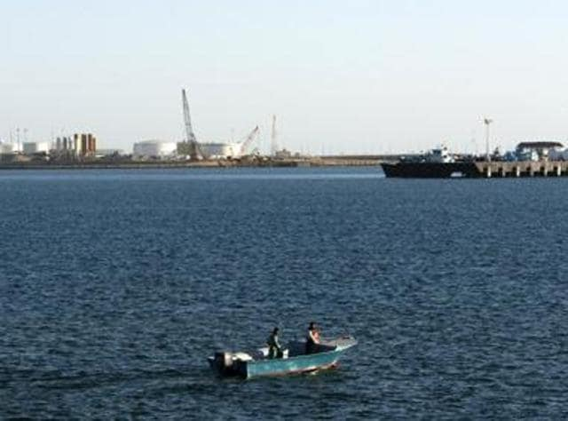 In this file photo, a speed boat passes by oil docks at the port of Kalantari in the city of Chabahar, east of the Strait of Hormuz.