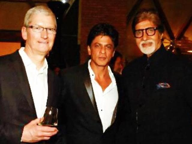 Shah Rukh Khan and Amitabh Bachchan strike a pose with Apple CEO Tim Cook.