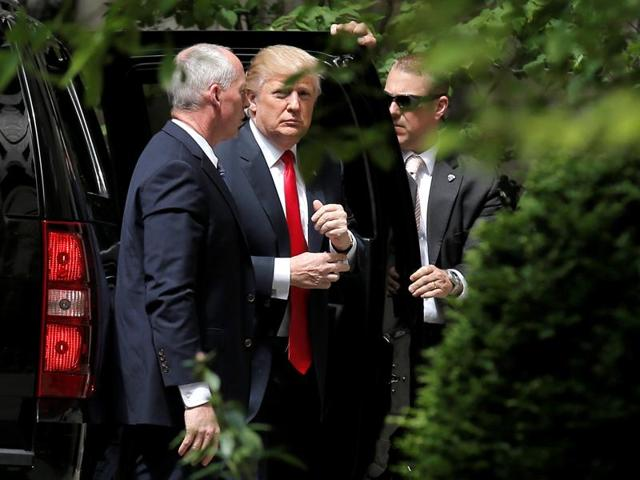 US Republican presidential candidate Donald Trump arrives for a meeting with former US secretary of state Henry Kissinger in New York City.