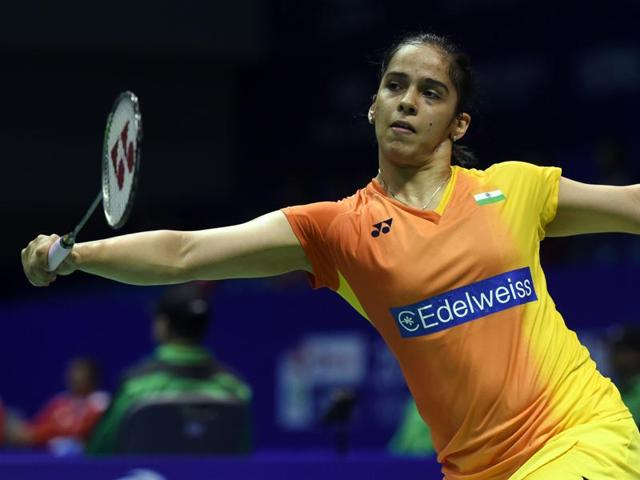 Saina Nehwal of India hits a return against Ratchanok Intanon of Thailand  during their Uber Cup match.