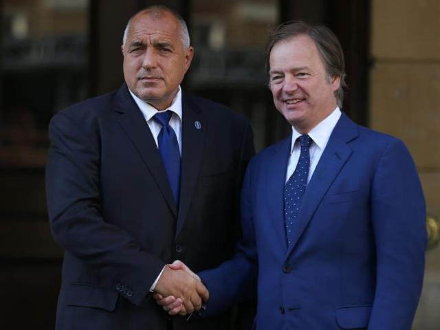 Bulgarian Prime Minister Boyko Borissov (L) is greeted by British Minister of State for the Foreign and Commonwealth Office Hugo Swire as he arrives to attend the Anti-Corruption Summit London 2016, at Lancaster House in central London on May 12, 2016.