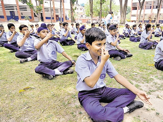 The board has informed schools that they can offer yoga as an activity to primary (classes 1-8) and secondary (classes 9-10) students, making it part of their daily school routine from the 2016-17 academic year. Photo by Ravi Kumar/Hindustan Times