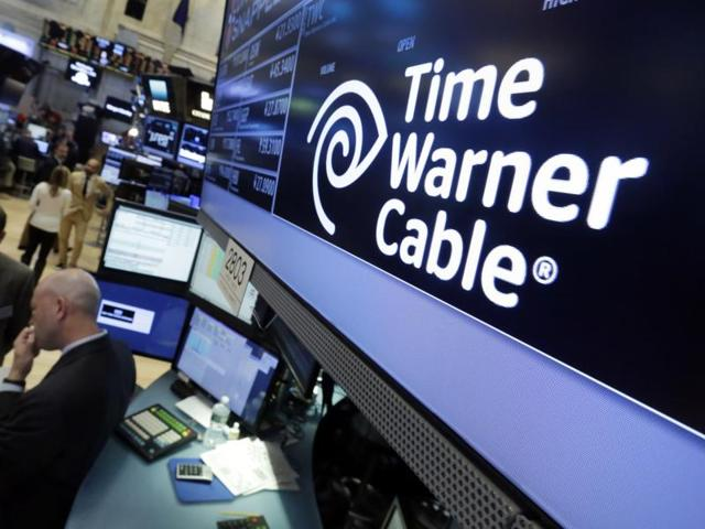 The Time Warner Cable logo appears above the post where it trades on the floor of the New York Stock Exchange.