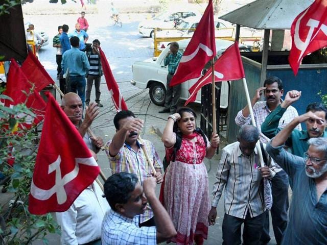 CPI (M) suppoters raise slogan as they celebrate the party's victory in Kerala Assembly elections, in New Delhi on Thursday.