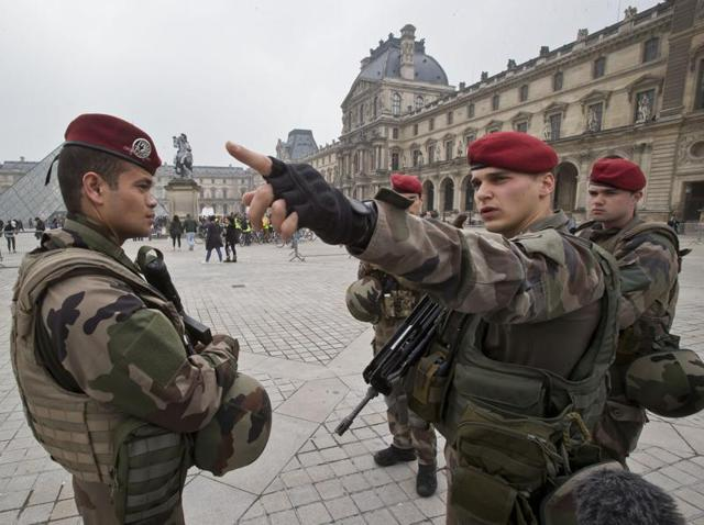A French soldier takes instructions from a staff sergeant at the Louvre museum in Paris.