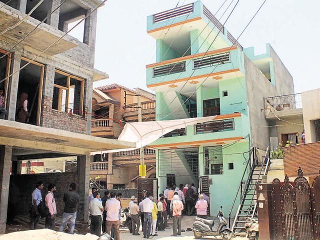 Friends and family gather outside Jiya's house in Krishna Colony near Sector 7, Old Gurgaon on Wednesday.
