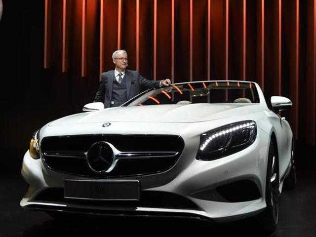Roland Folger, managing director and CEO of Mercedes Benz India, poses with the S500 Mercedes Benz car at the Indian Auto Expo 2016.