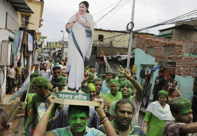 Trinamool Congress party supporters celebrate after winning the West Bengal state assembly election in Kolkata.