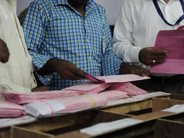 Election officials count postal ballots at a counting center in Chennai on May 19, 2016. Vote-counting is takaing place following state assembly elections in Tamil Nadu, Kerala and Pondicherry.