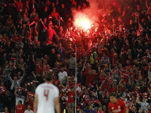 Liverpool fans light a flare at St Jakob-Park, Basel, Switzerland .