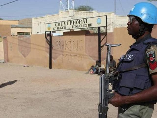UN peacekeepers stand guard near an airport in Timbuktu, central Mali. Five Chadian peacekeepers were killed and three others wounded in a shootout during an ambush in country's Kidal region.