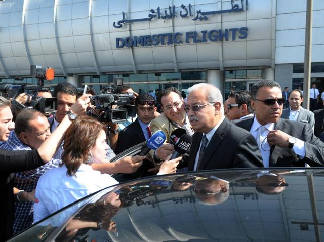 Egyptian Prime Minister Sherif Ismail talks to reporters at Cairo International airport. Ismail said it was too early to say whether a technical problem or a terror attack caused the plane to crash.