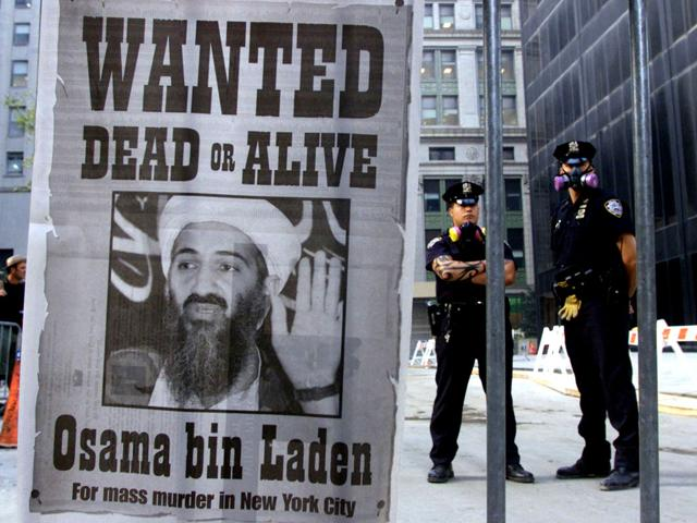 New York Police stand near a wanted poster of former al Qaeda chief Osama bin Laden.