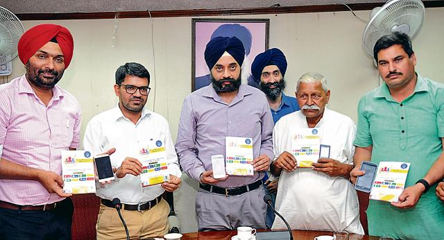 Deputy commissioner Ramvir Singh and mayor Amarinder Singh Bajaj launching Municipal Corporation Citizens Reporting and Mapping Tool at MC office in Patiala on Wednesday.