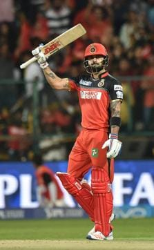 Virat Kohli extended his sensational run by scoring his fourth century of this IPL season despite a torn webbing in his left hand suffered in the previous game. RCB won the rain-hit tie comfortably on Wednesday.