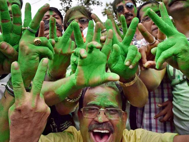 TMC supporters and workers celebrating their win outside the counting centre in Kolkata on  May 19.