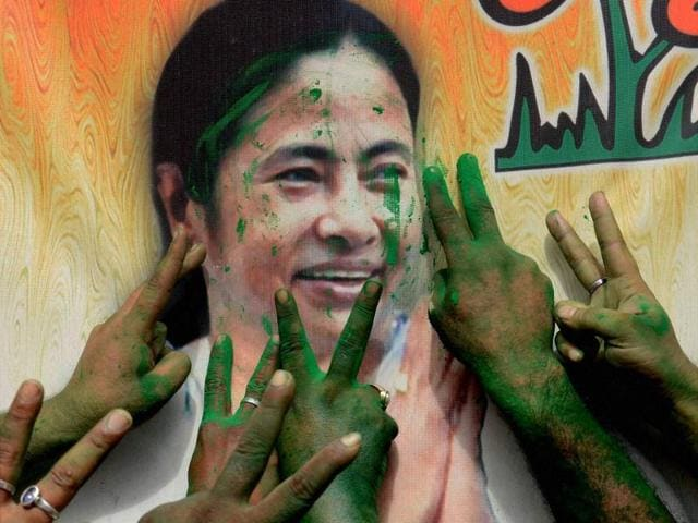 West Bengal CM Mamata Banerjee waves to supporters after her party's win in West Bengal Assembly elections, in Kolkata, May 19, 2016