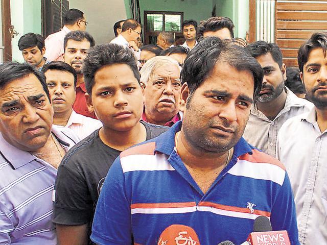 Jiya's father Pankaj Juneja (centre) says has accepted his daughter's destiny.