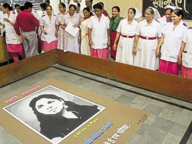 KEM hospital staff and nurses pay their respect on the first death anniversary of Aruna Shanbaug at KEM hospital in Mumbai on Wednesday.