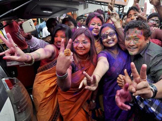 BJP workers dance as they celebrate their party's victory in the Assam assembly elections, in Guwahati on Thursday.